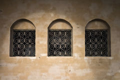 Old wall with three ancient windows. An old wall with three ancient windows background texture Royalty Free Stock Photography