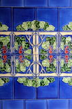 Old wall tiles with floral pattern Stock Photos