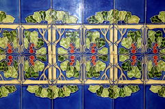 Old wall tiles with floral pattern Stock Photo