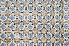 Old wall with traditional Portuguese decor tiles azulezhu in blue and brown tones on a beige background. Old wall with traditional Portuguese decor tiles stock photos