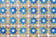 Old wall with traditional Portuguese decor tiles azulezhu in blue,yellow and brown tones. Old wall with traditional Portuguese decor tiles azulezhu in blue royalty free stock image