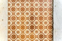 Old wall with traditional Portuguese decor tiles azulezhu in brown tones. Old wall with traditional Portuguese decor tiles azulezhu in brown tones royalty free stock photography
