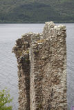 Old wall of Urqhart Castle. Remaining ancient wall of medieval Urqhart castle at the shore of Loch Ness in Scotland Royalty Free Stock Photography