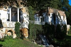 Old wall with waterfall in the park stock photos