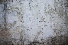 White wall texture with peeling paint and slime marks. Old wall with white paint peeling off texture in black and white tone stock photography