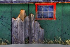 Old wall and window. Old wall with peeling siding and a red framed window using HDR processing Stock Photography