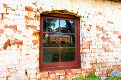 Old wall, windows and reflection stock photo
