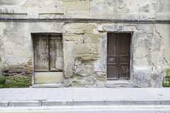 Old wall with wooden doors Stock Photography