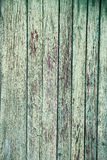 Old wall from wooden planks with green paint traces Stock Image