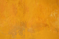 Old wall yellow grunge texture. Yellow wall painting old grunge texture Stock Images