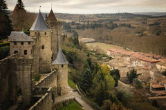 Old walled citadel. Carcassonne. France. The old walled citadel and the modern village. Ramparts and towers. Carcassonne. France Royalty Free Stock Photos