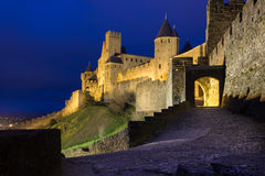 Old walled citadel at night. Carcassonne. France Stock Image