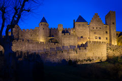 Old walled citadel at night. Carcassonne. France Stock Images