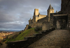 Old walled citadel at sunset. Carcassonne. France Royalty Free Stock Photography