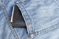 Old wallet in back pocket jeans Stock Photo