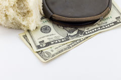 Old wallet / purse with dollar notes and a crust of bread Stock Photos