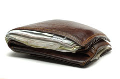 Old wallet with useless papers. Worn out wallet with useless papers inside Royalty Free Stock Photo