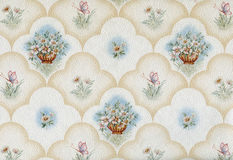 Old wallpaper element. Old textile wallpaper detail with floral design Royalty Free Stock Image