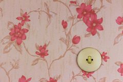 Old wallpaper with light switch Stock Image