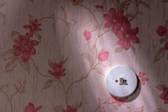Old wallpaper with light switch Royalty Free Stock Photography