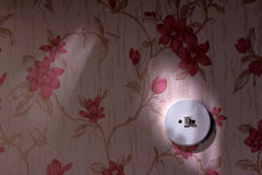 Old wallpaper with light switch Stock Photography
