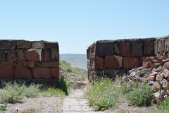 Old walls in Erebuni. Armenia, with the view of ther nearby hills Royalty Free Stock Photos