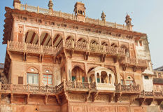 Old walls of Ramnagar Fort with carved arches and balconies in Varanasi Stock Photo