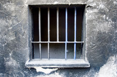 Old walls, rusty iron barred window. Background Royalty Free Stock Image