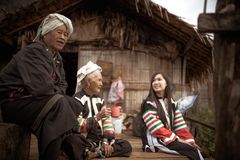 Old wamen in small house make by bamboo. In North of Thailand have a small community. And every women have stay at home and old women for take care a traveler Stock Image