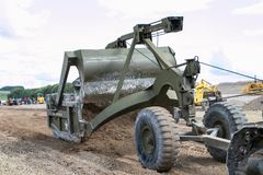 An old war digger moving soil Royalty Free Stock Photo