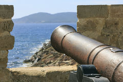 Old war iron canon in Sardinia.  Royalty Free Stock Photography