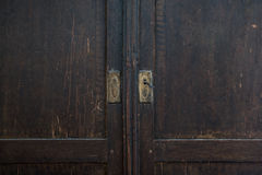 Old wardrobe door detail. Closeup photo of old wardrobe door. Detail Stock Images