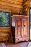 Old wardrobe in log cottage. Photo of an old wardrobe in log cottage Royalty Free Stock Photography