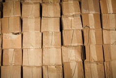 Old warehouse. Old dirty cardboard boxes in a warehouse. Contept of obstacle in business, the stale goods Stock Photo