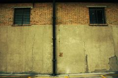 Old warehouse brick wall with two windows Stock Image