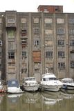 Old warehouse on Bristol waterfront with smart boats Royalty Free Stock Image