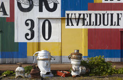 Old warehouse with colorful metallic facade. Royalty Free Stock Photos
