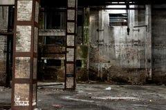 Old warehouse in disrepair, abandoned building interior. Abandoned building interior, old warehouse in disrepair, dangerous industrial zone Stock Photography