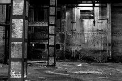 Old warehouse in disrepair, abandoned building interior. Abandoned building interior, old warehouse in disrepair, dangerous industrial zone Royalty Free Stock Photos