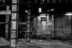 Old warehouse in disrepair, abandoned building interior. Abandoned building interior, old warehouse in disrepair, dangerous industrial zone Stock Photo