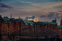 The old warehouse district Speicherstadt in Hamburg, Germany with Elbphilharmonie concert hall in background, royalty free stock images