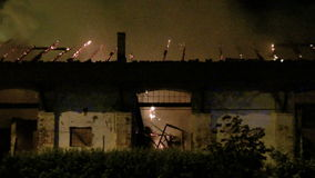 Old warehouse on fire at night stock footage