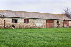 Old warehouse with grass Stock Image