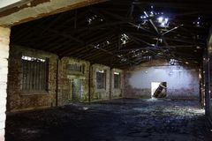 Old warehouse from the inside. With light Royalty Free Stock Image