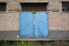 Old Warehouse with wooden sliding doors stock photo