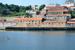 Old warehouses by the river Douro Stock Image
