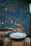 Old washbasin. Filled with sand is sitting in a wooden bench Royalty Free Stock Photos