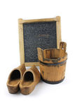 Old washboard, wooden bucket, shoes - white background Stock Photo
