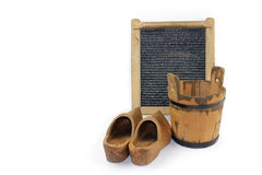 Old washboard, wooden bucket, shoes - white background Stock Photos