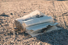 Old washed up book in desert Royalty Free Stock Image